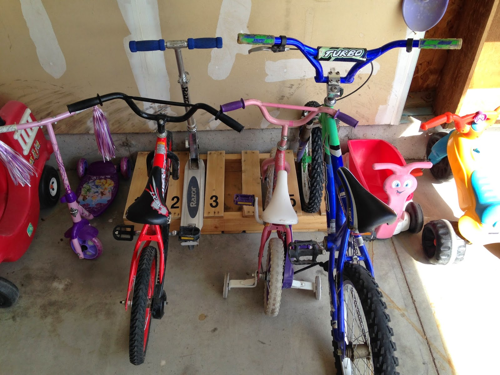 1 weekend garage organization the realistic mama diy bike rack solutioingenieria Image collections